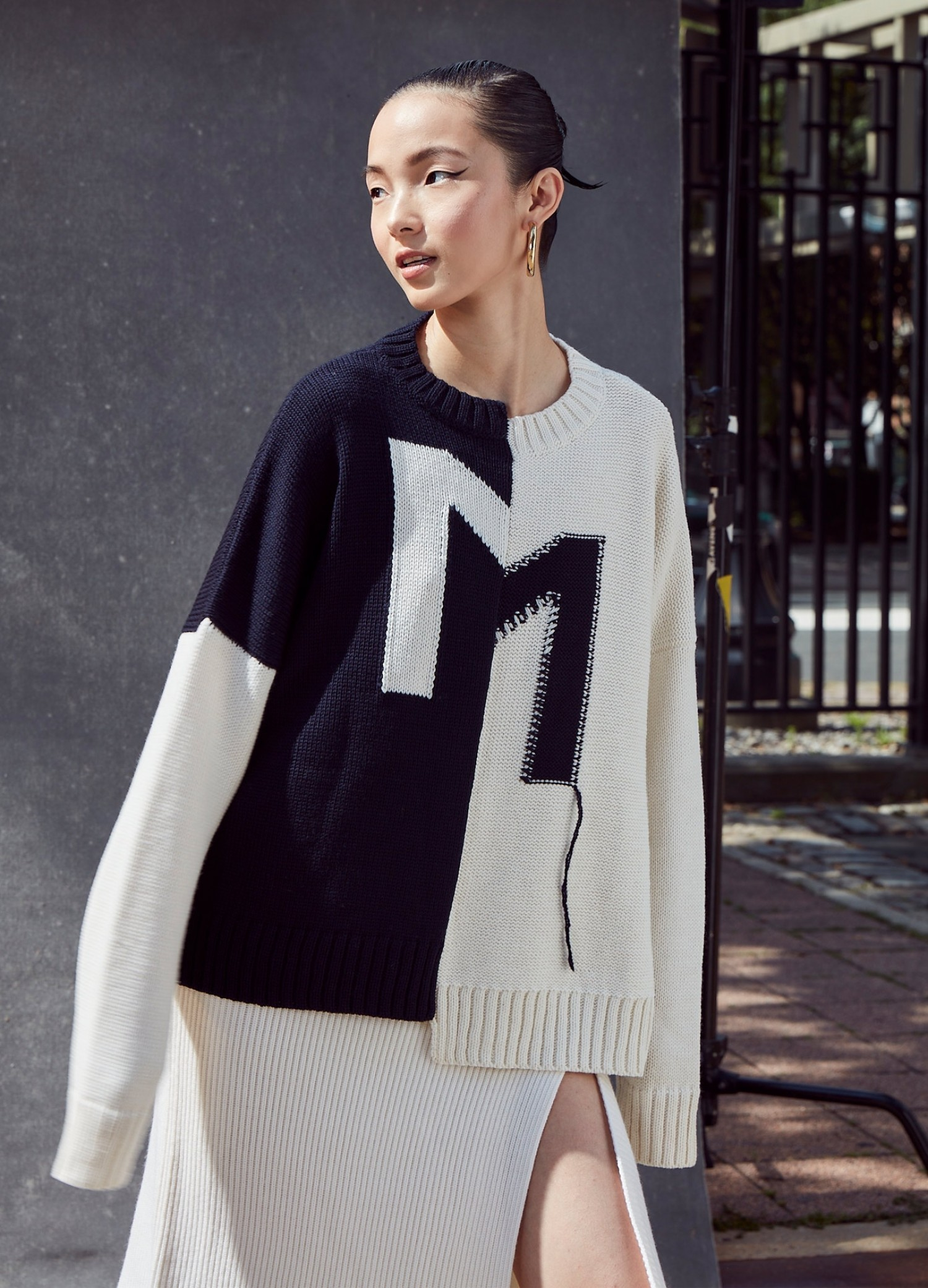 MONSE Crooked M Pullover Sweater in Ivory and Midnight on Model Front View