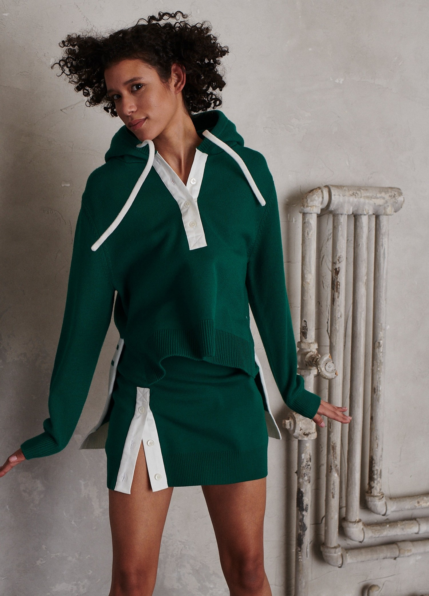 MONSE Rugby Knit Mini Skirt in Grass and Ivory on Model Jumping Front View
