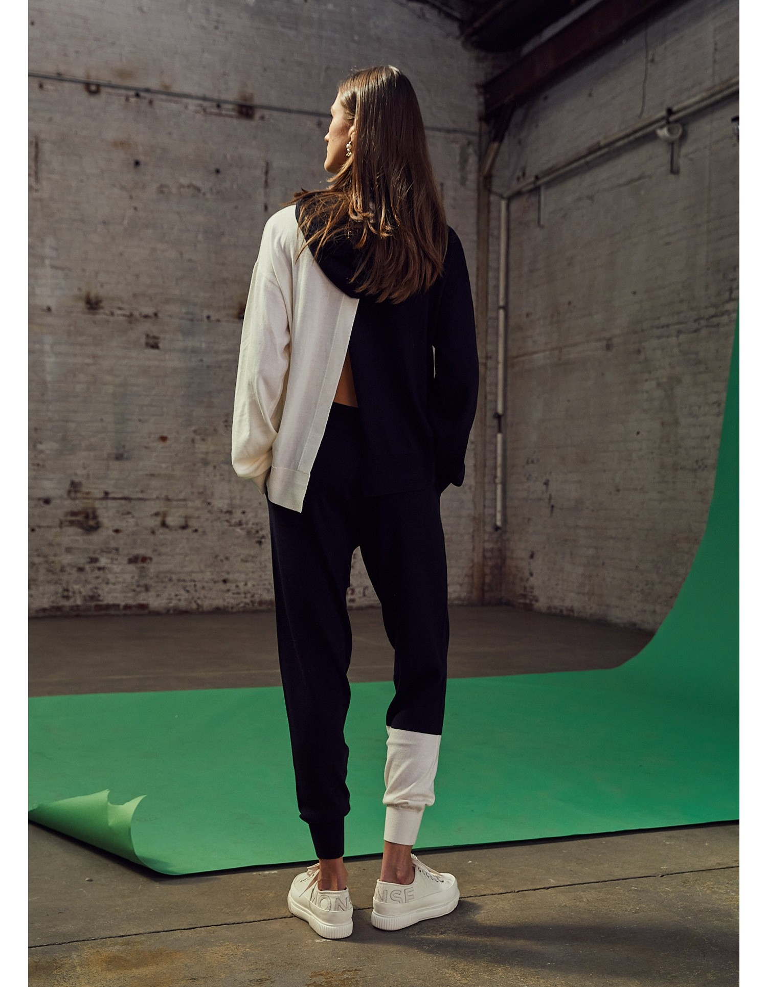 MONSE Knitted Color Block Sweatpant in Midnight and Ivory on Model Front View