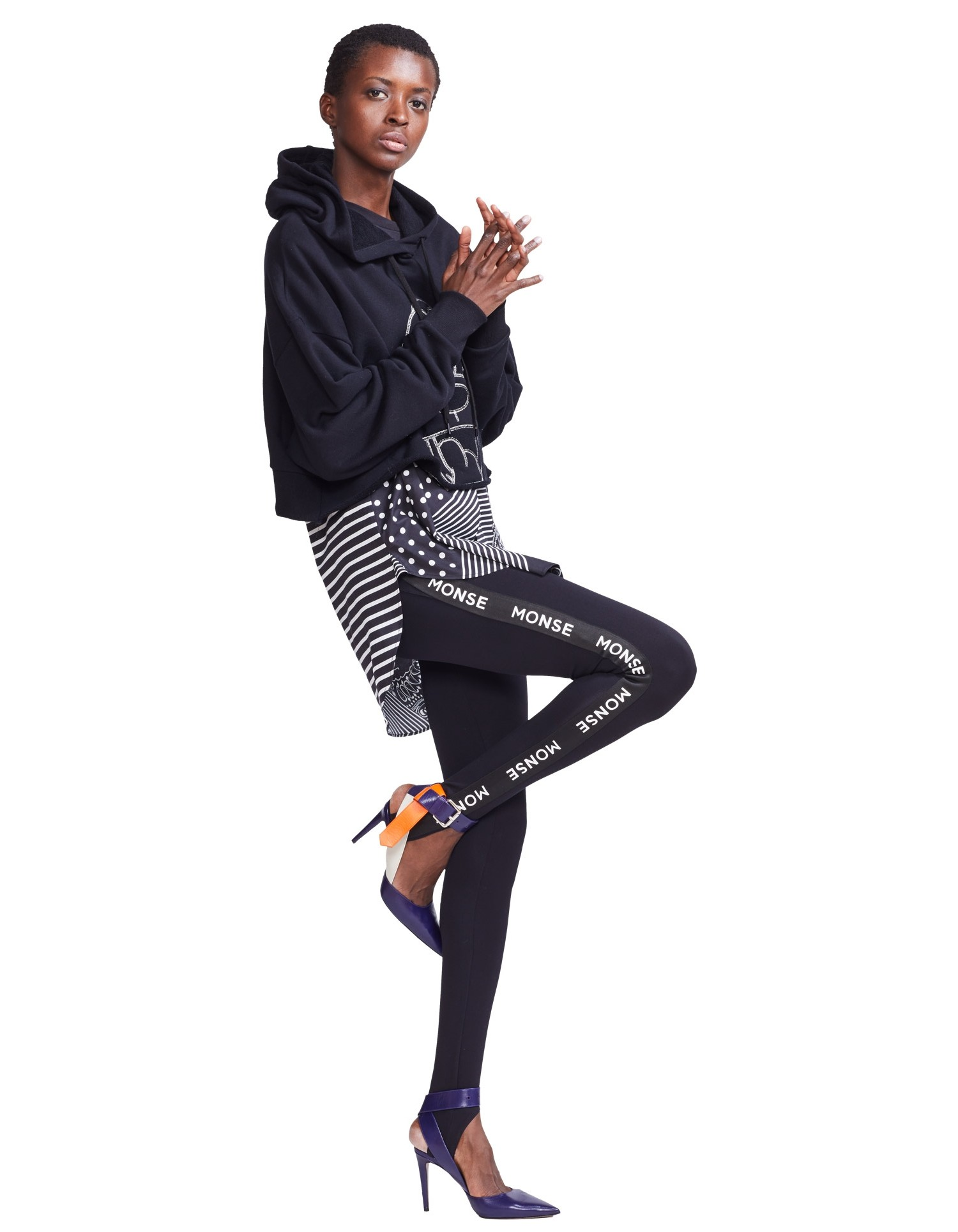 Monse Unisex Logo Leggings on Model Side View