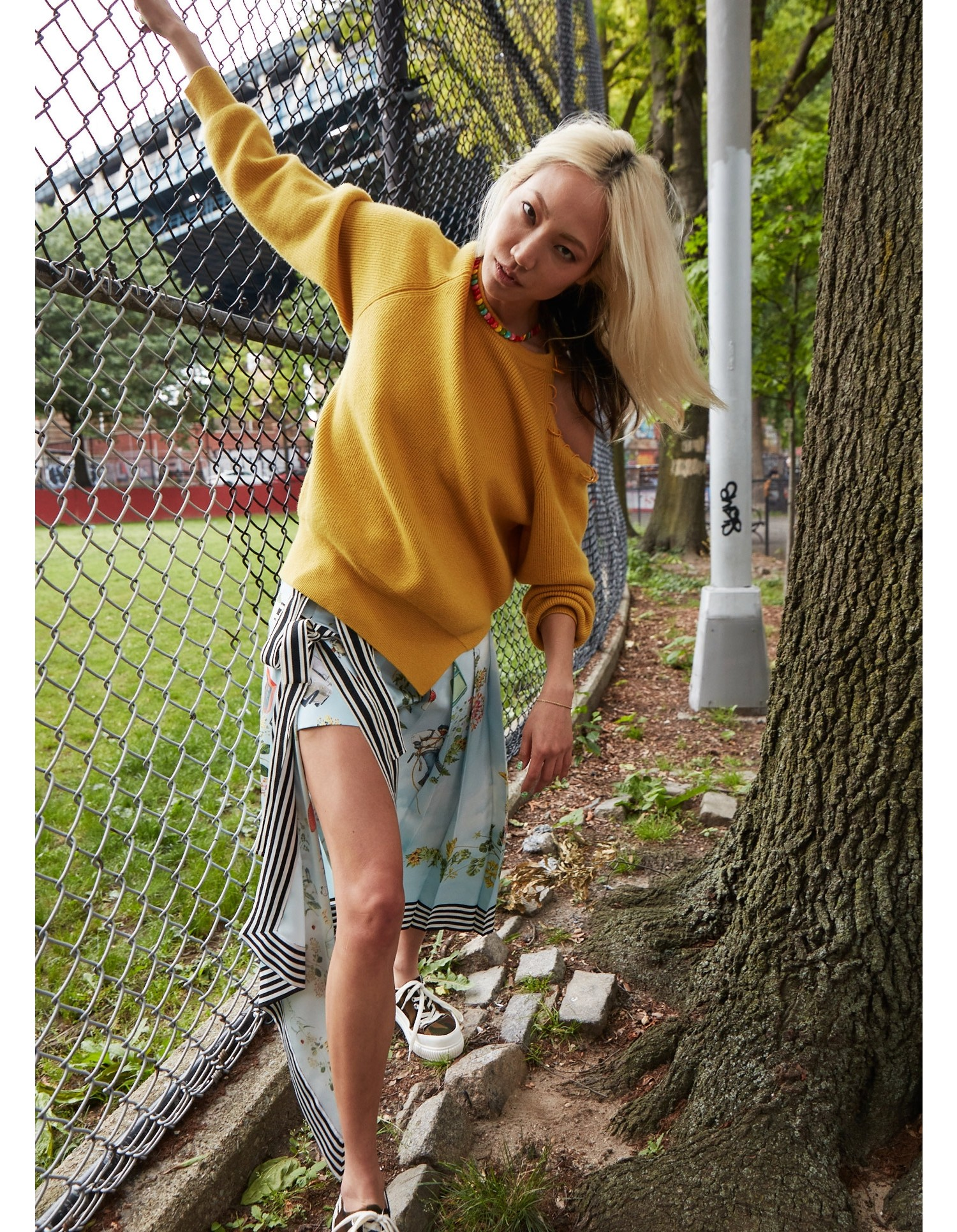 MONSE Pierced Cut Out Shoulder Sweater on Model Front View