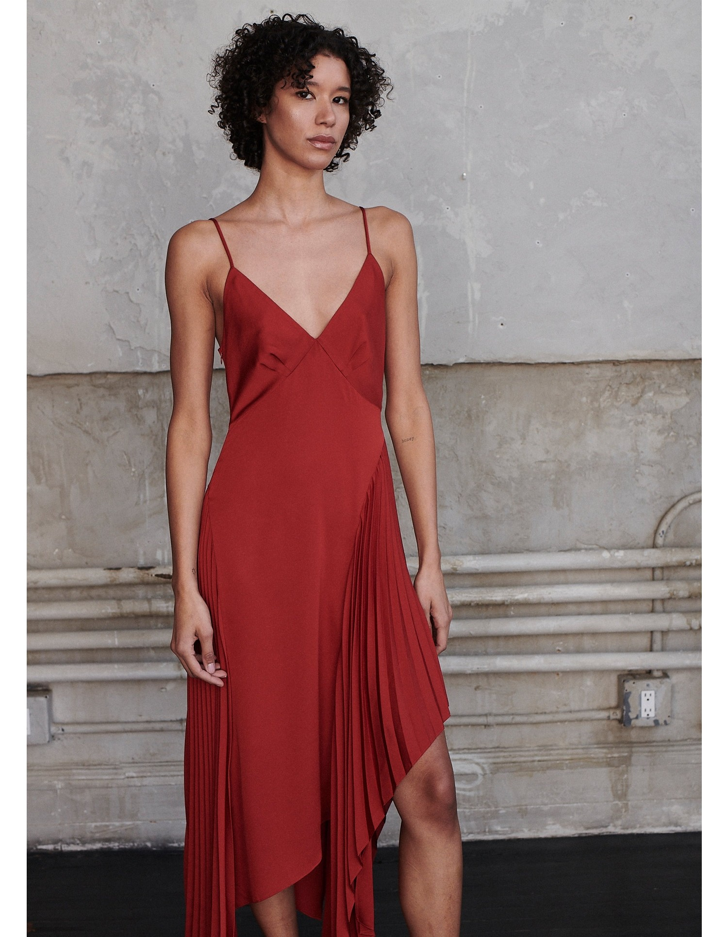 MONSE Pleated Slip Dress in Rust on Model Front View