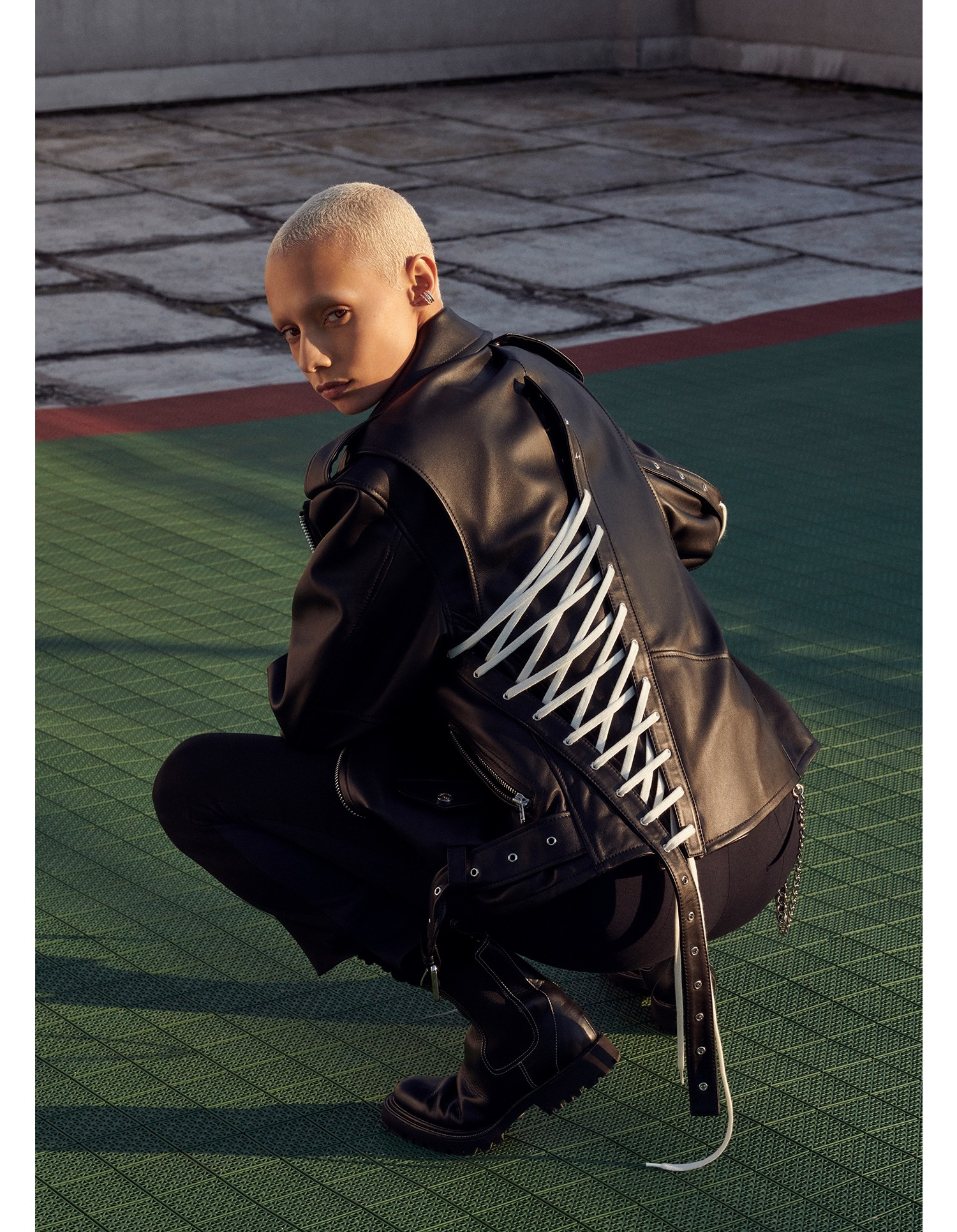 MONSE Lace Up Leather Motorcycle Jacket in Black on Model Crouching Down Back View