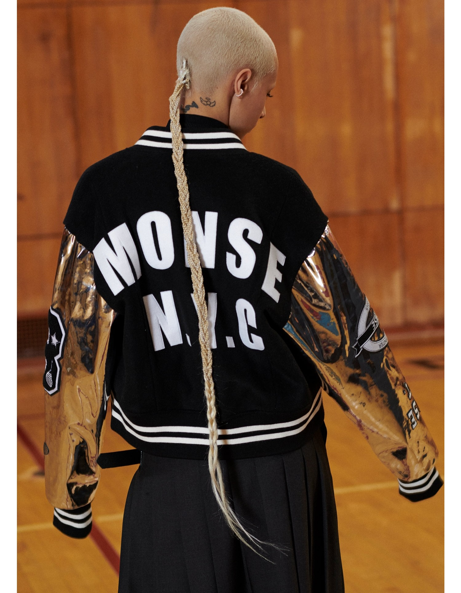 MONSE Cropped Letterman Jacket in Black and Silver on Model Back View