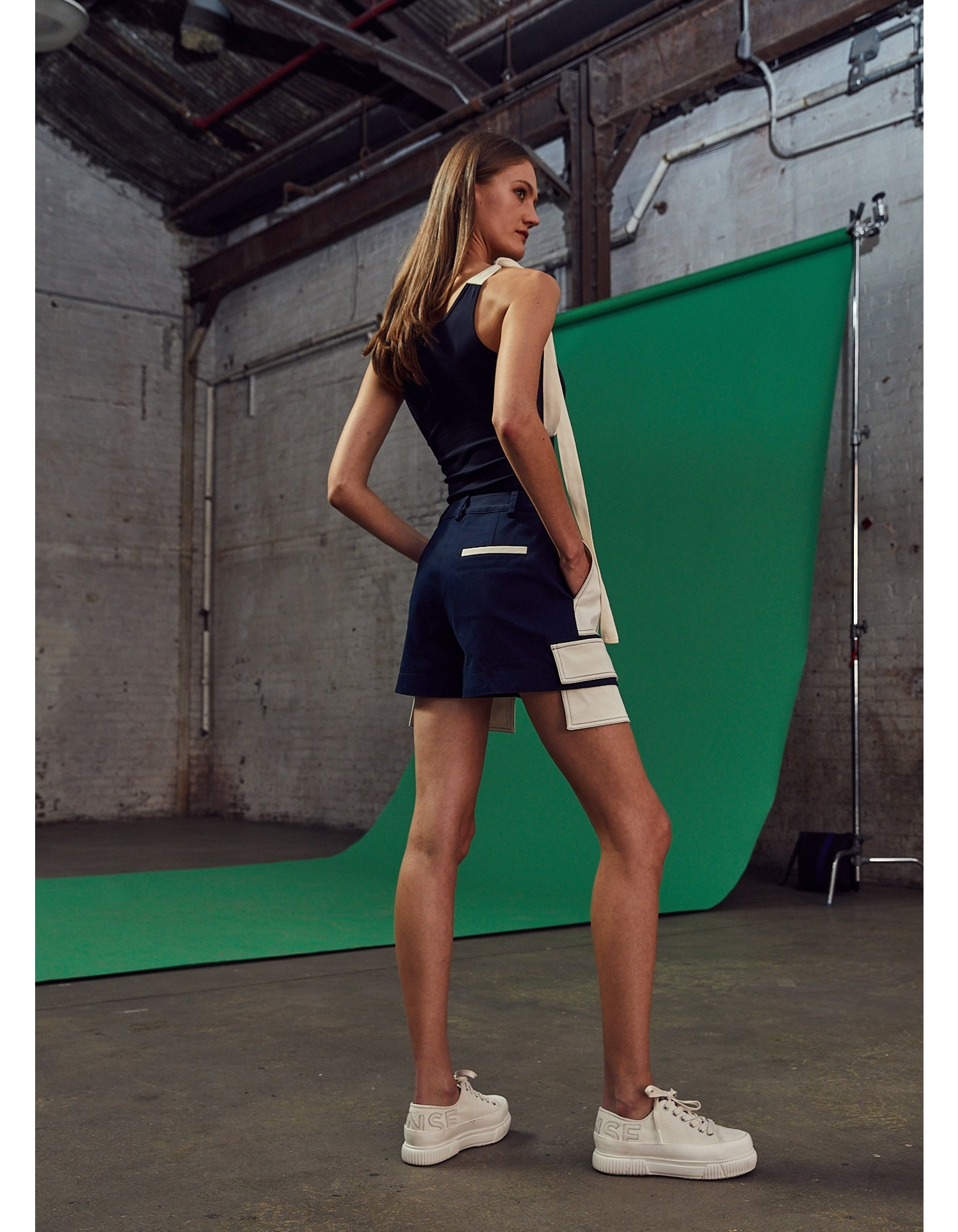 MONSE Extended Patch Pocket Shorts in Midnight and Ivory on Model Back View