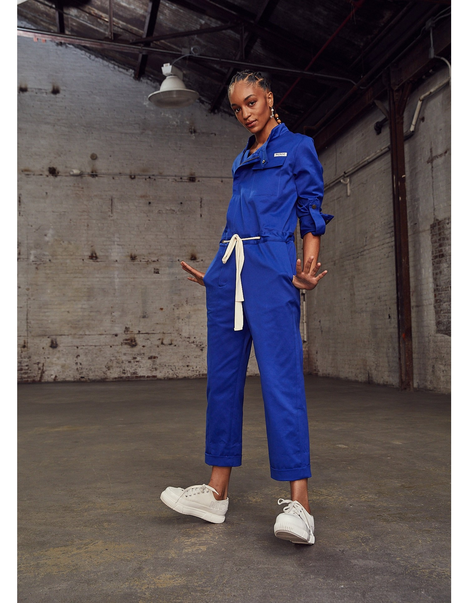 MONSE Racer Jumpsuit in Electric Blue on Model Front Side View