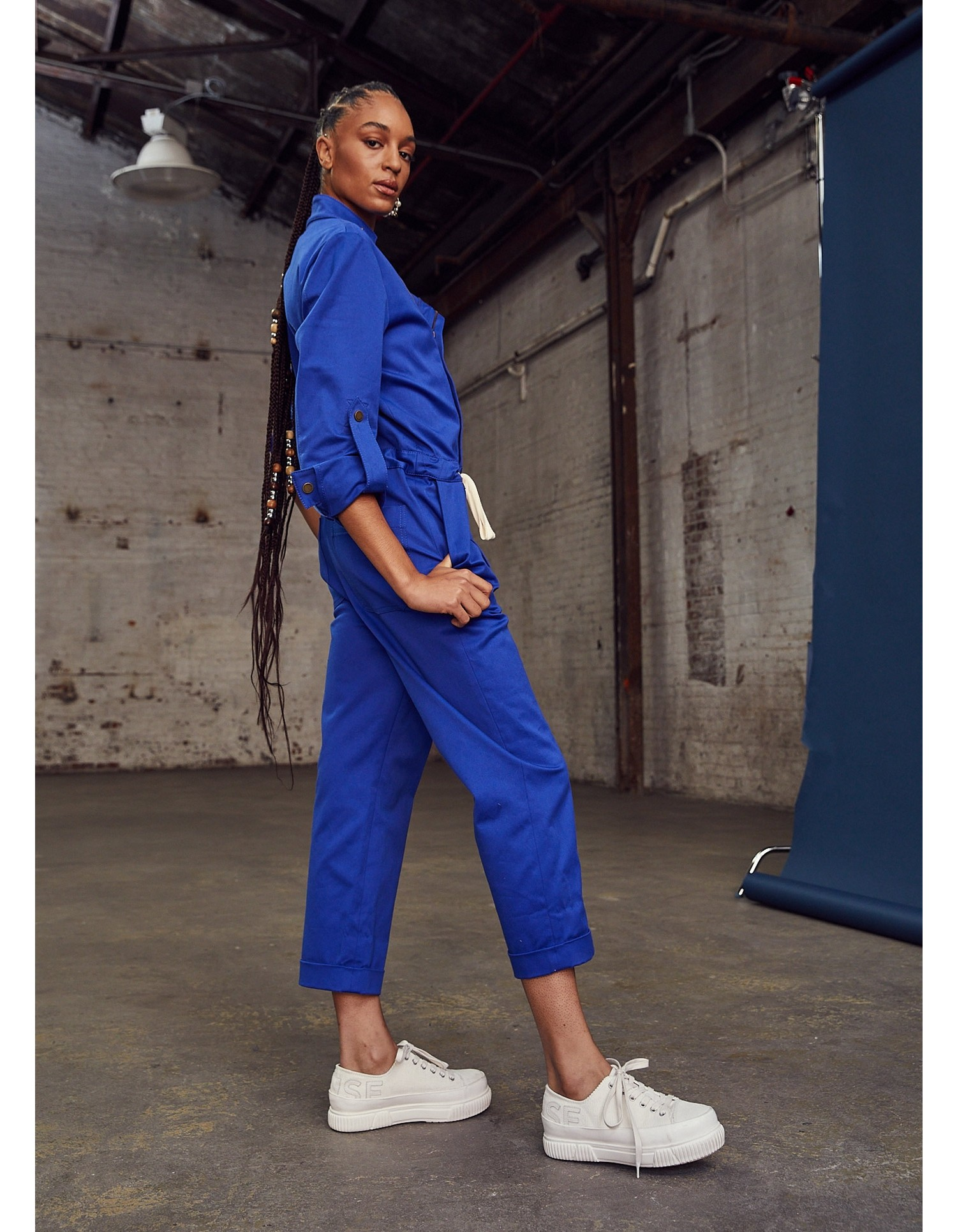MONSE Racer Jumpsuit in Electric Blue on Model Side View