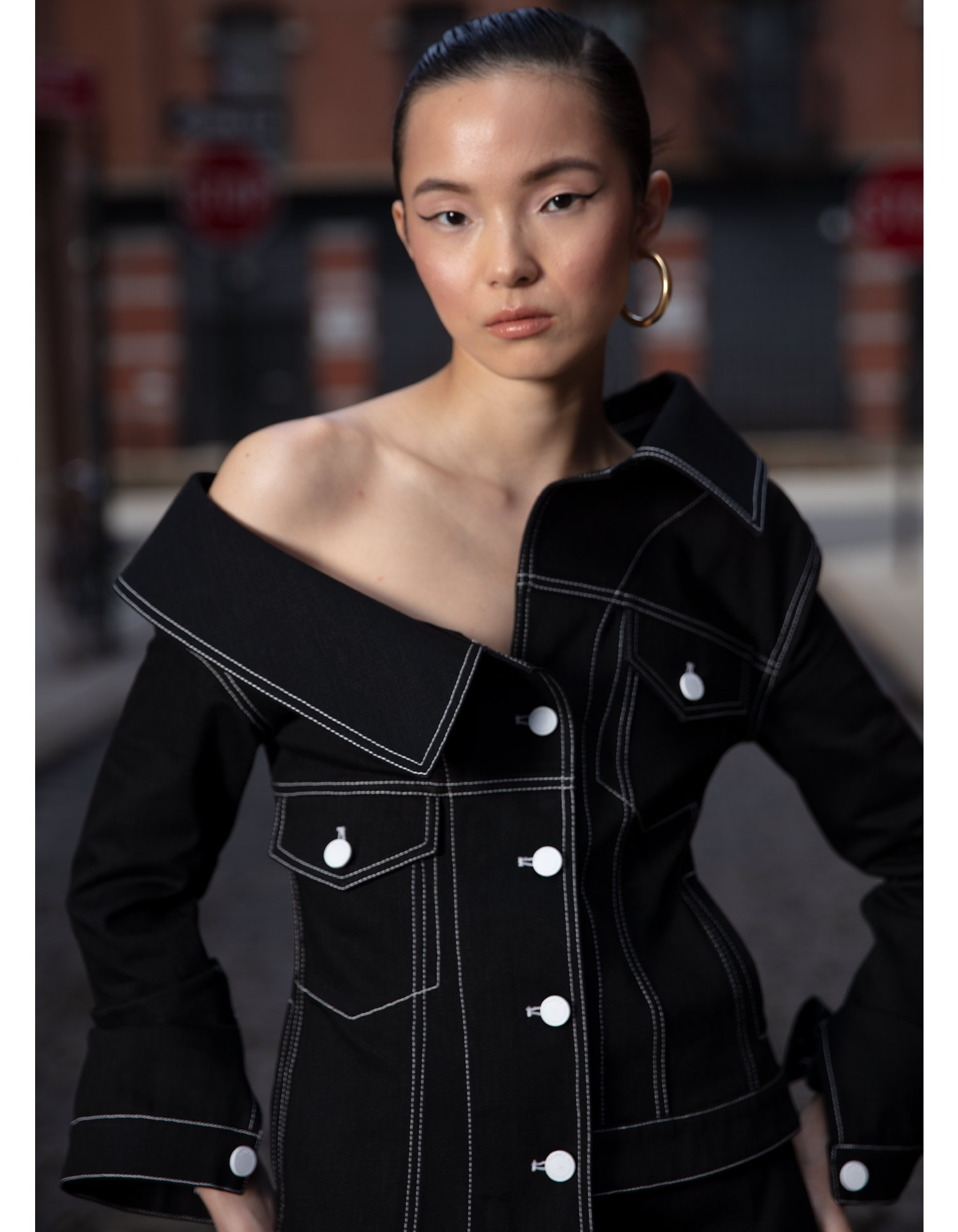 MONSE Crooked Denim Jacket in Black on Model Front Detailed View