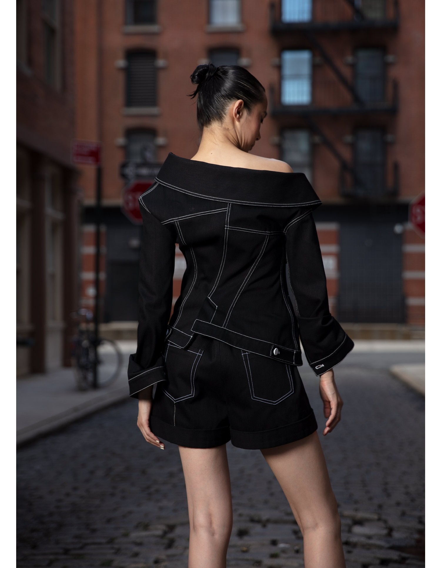 MONSE Crooked Denim Shorts in Black on Model Back View