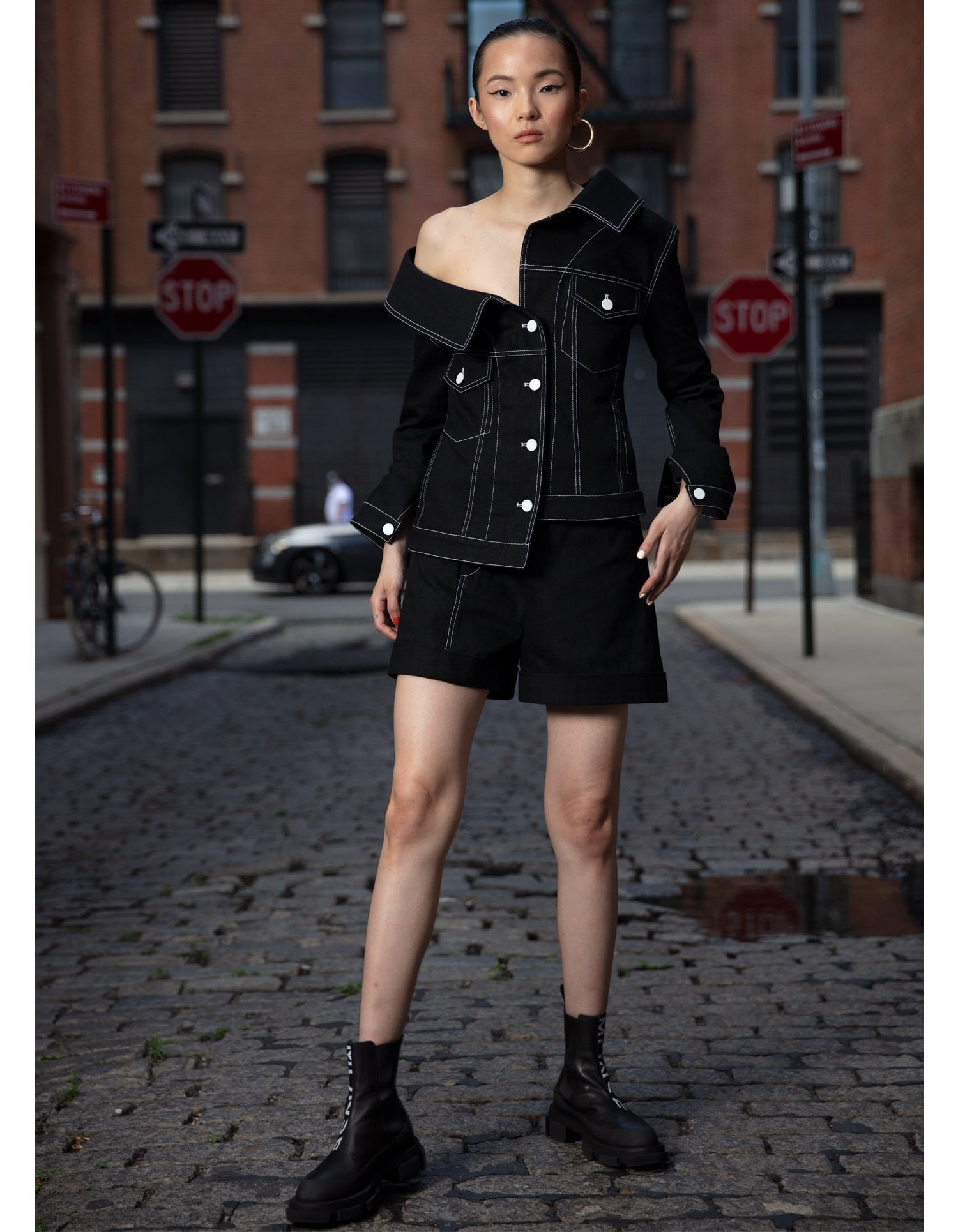 MONSE Crooked Denim Shorts in Black on Model Front View