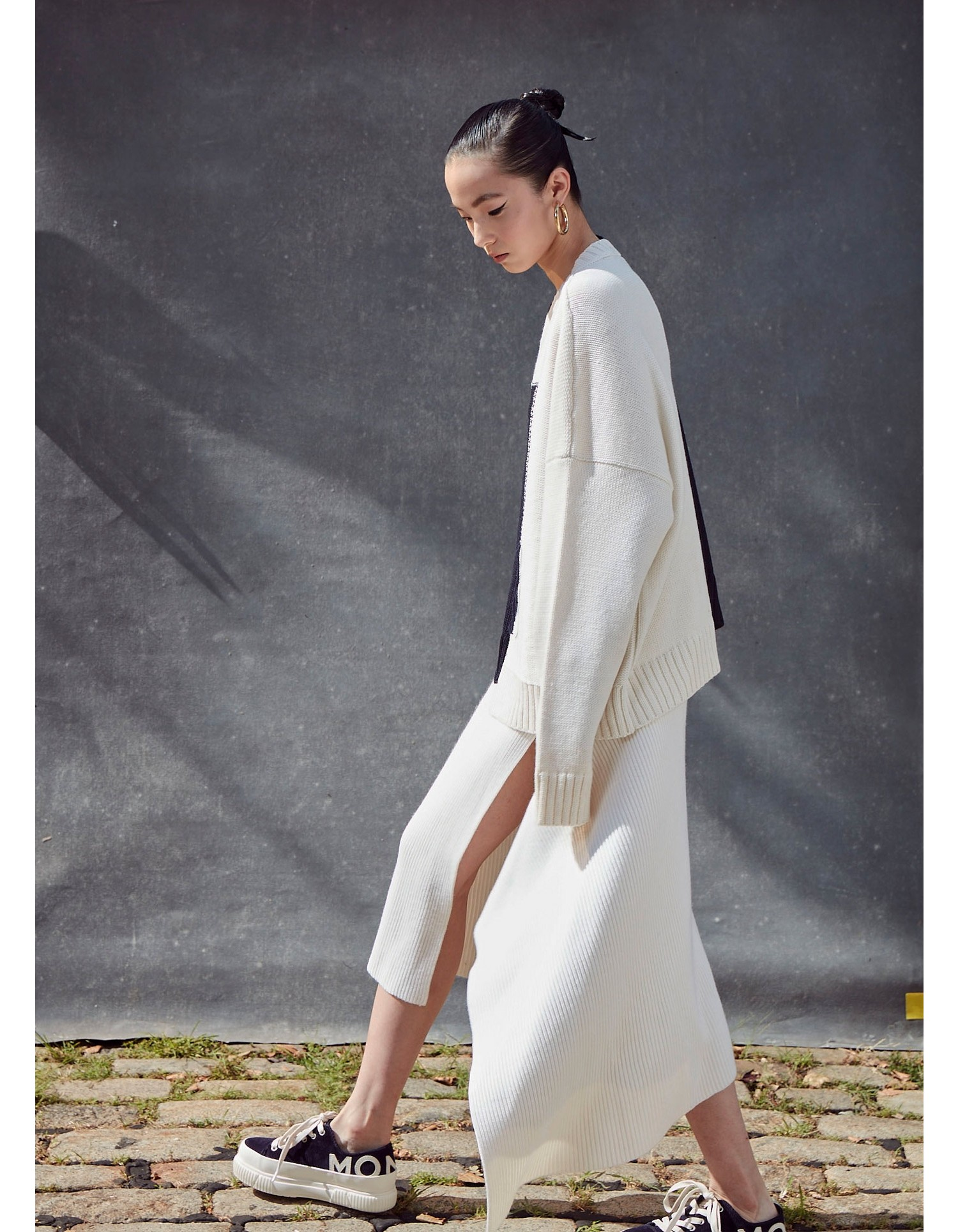 MONSE Sliced Ribbed Knit Skirt in Ivory on Model Side View