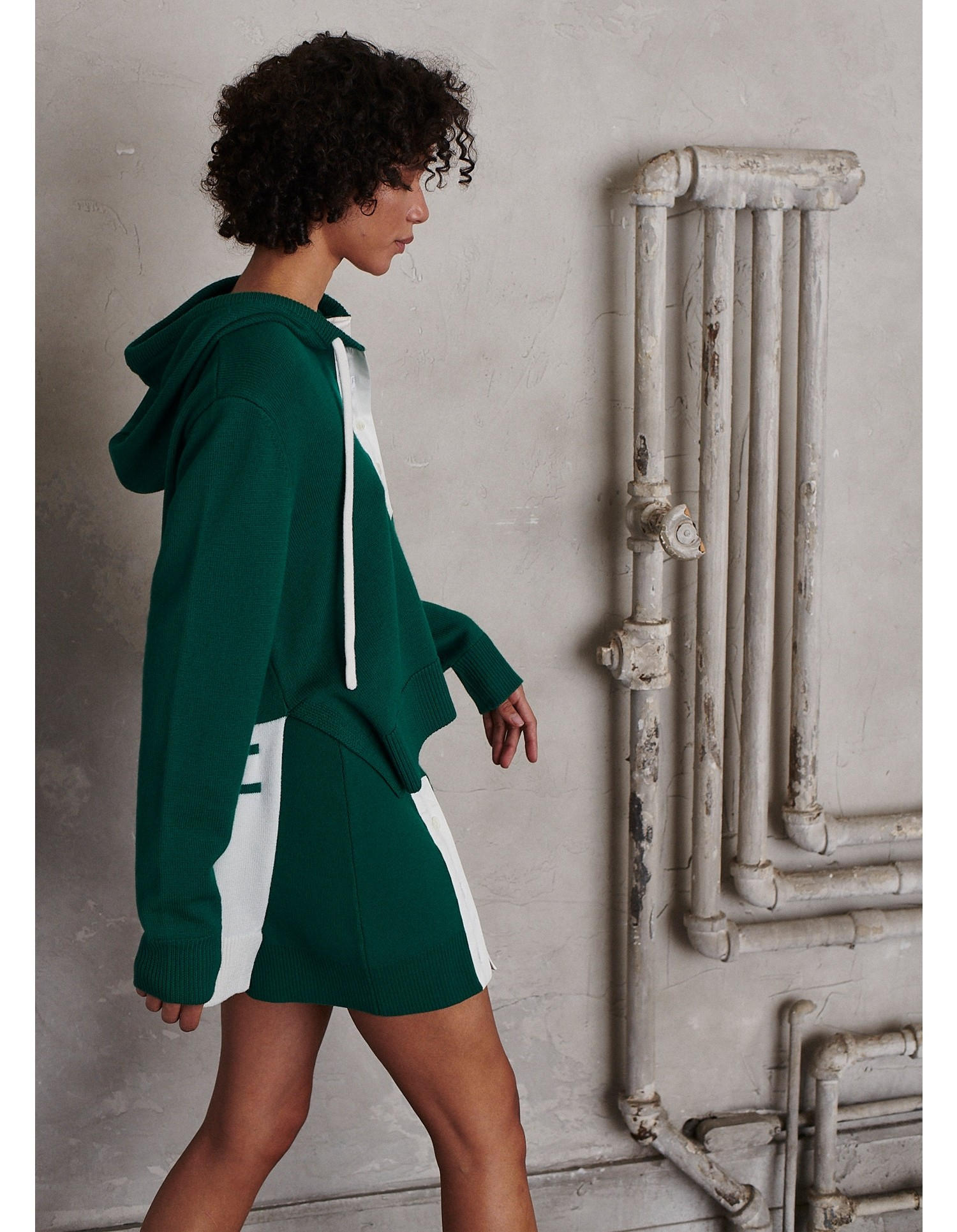 MONSE Rugby Knit Mini Skirt in Grass and Ivory on Model Side View