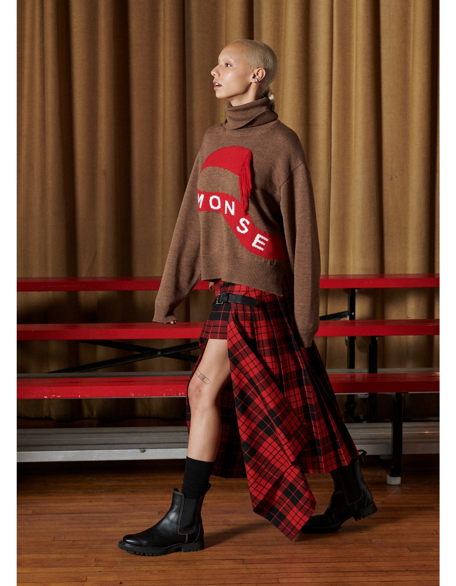 MONSE Tartan Pleated Academy Skirt in Scarlet and Black on Model Side View